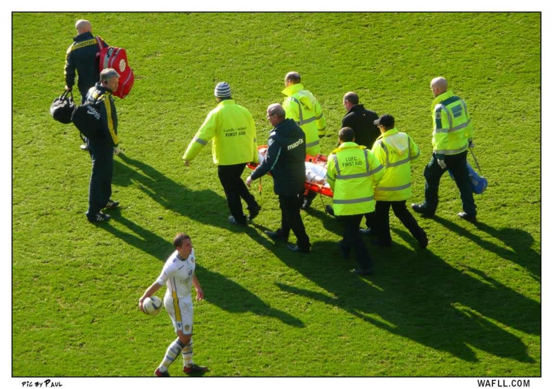 Varney Stretchered Off